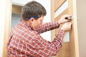 Locksmith removing door and installing a new door in Bloomsbury